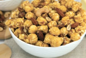 Nutty Caramel popcorn in bowl with almonds