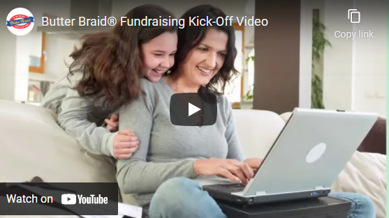 Butter Braid Kick-Off video screenshot of mom and daughter on computer with play icon over image